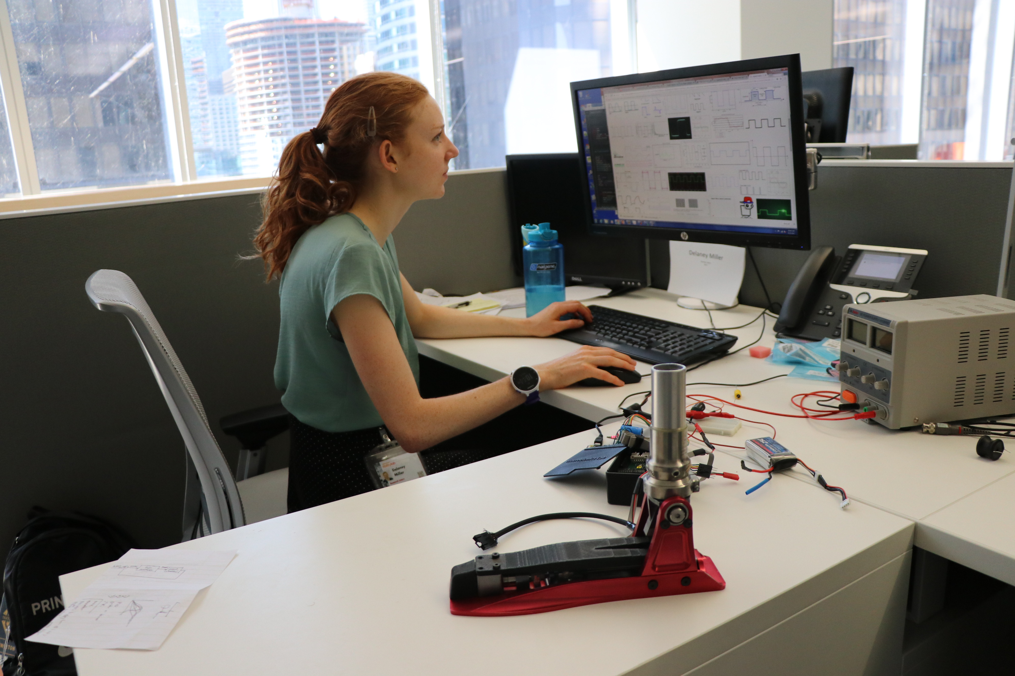 Intern working on developing a control system for an ankle prosthesis