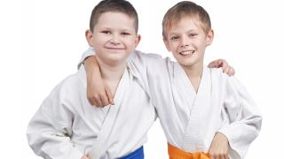 Two children taking karate classes