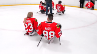 kevin and Erica on the ice after Blackhawks sled hockey game