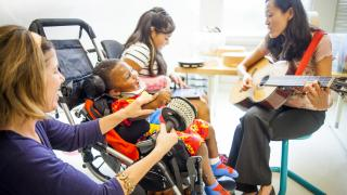 Music therapist works with a pediatric patient