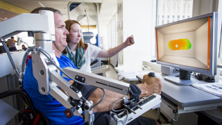 Patient uses technology for stroke rehabilitation