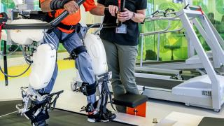 Cerebral Palsy patient using machinery for rehabilitation