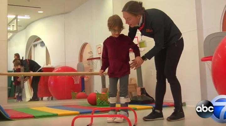 child with CP interacts with therapist at Shirley Ryan AbilityLab