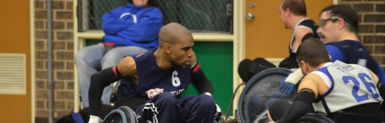 Wheelchair rugby players go for the ball