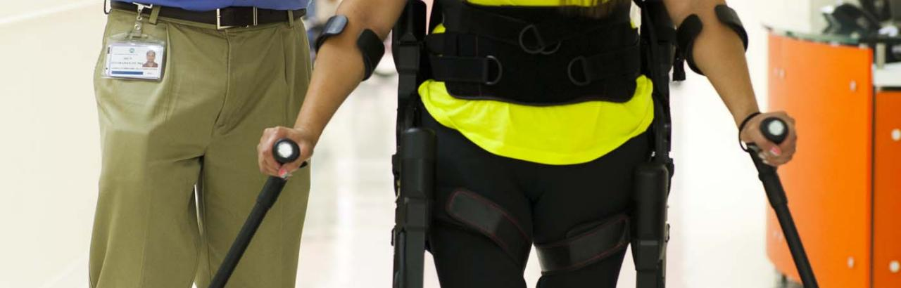 Patient uses ExoSkeleton to walk