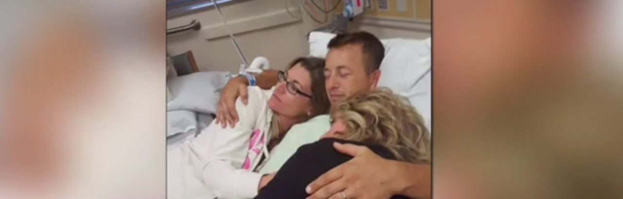 Cole hugs his family while recovering from the SCI
