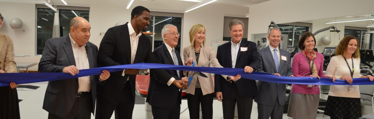 Joanne C. Smith, MD, president and CEO of Shirley Ryan AbilityLab,  Homewood Mayor Rich Hofeld and Illinois State Senator Napoleon B. Harris, and others cut the ribbon at the new Homewood DayRehab Center