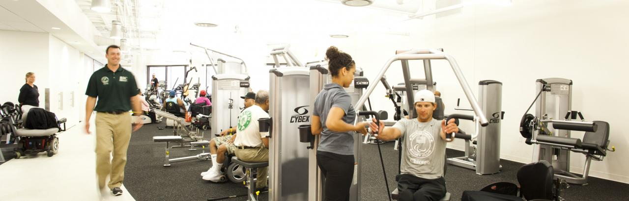 People on exercise machines at Adaptive Fitness Center