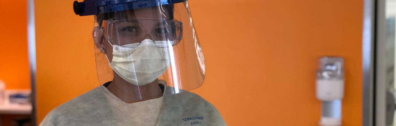 A nurse wears full PPE on the COVID recovery unit