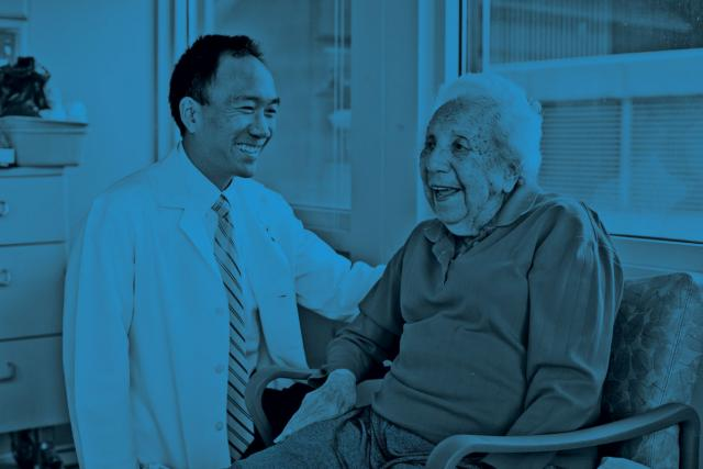 physician smiling with stroke patient