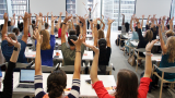 learners at an Academy course raising their hands